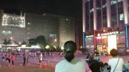 People dancing in the street at night