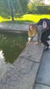 Marta feeding fish