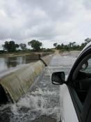 Überschwemmte Brücke im Krüger
